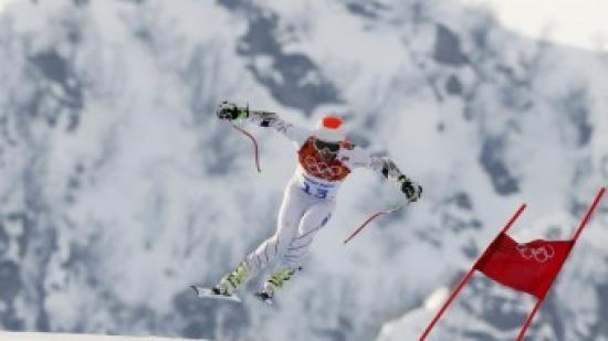 Bode Miller fa un salt durant la seva baixada Foto:REUTERS