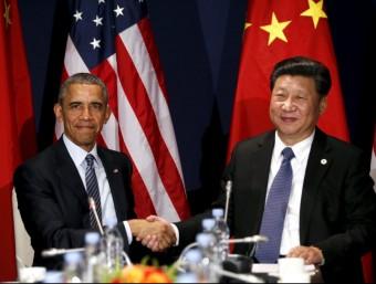 Els presidents nord-americà, Barak Obama i el seu homòleg xinès, Xi Jinping a París.  ARXIU /REUTERS