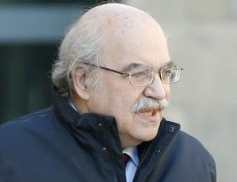Andreu Mas- Colell, amb el secretari general d'Economia, Albert Carreras, abans del consell executiu del govern efe