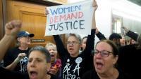 Manifestants protestant contra la candidatura de Brett Kavanaugh a jutge del Tribunal Suprem, a Washington DC, ahir