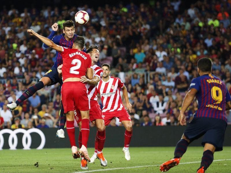 Gerard Piqué, fent la rematada amb el cap que va suposar l'empat definitiu del Barça contra el Girona