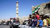 Un grup de persones protesten per un eventual atac a Idlib, el mes passat, a la localitat siriana de Kafr Nabl