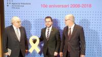 Mas-Colell, Aragonès i Castells, ahir amb un llaç groc en record d'Oriol Junqueras