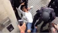 Una dona es agafada per la boca i arrossegada , a l'escola Dolors Monserdà, l'1-O