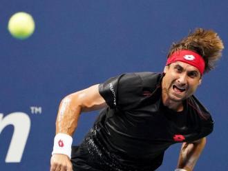 Ferrer fa un servei a l'obert dels EUA durant el seu últim partit en un torneig de Grand Slam