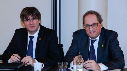 Carles Puigdemont i Quim Torra, en la reunió de Junts per Catalunya a l'hotel Marivaux de Brussel·les