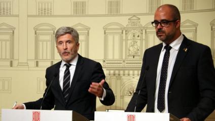 El ministre d'Interior, Grande-Marlaska, i el conseller, Miquel Buch