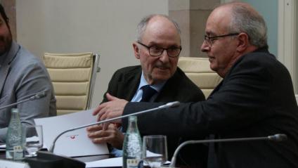 El síndic i el conseller durant l'acte al Parlament